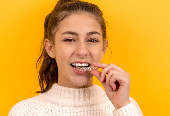 What are invisible and clear aligners?